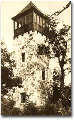 A stone fire tower in the past