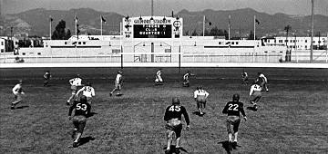 View of Gilmore Stadium scoreboard. Scene from a Three Stooges movie. Three Little Pigskins.