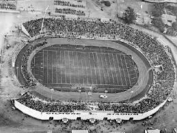 Aerial view with good view of midget car race track in Gilmore Stadium.