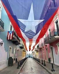 """La Calle Fortaleza"" adorned with the flag of Puerto Rico"