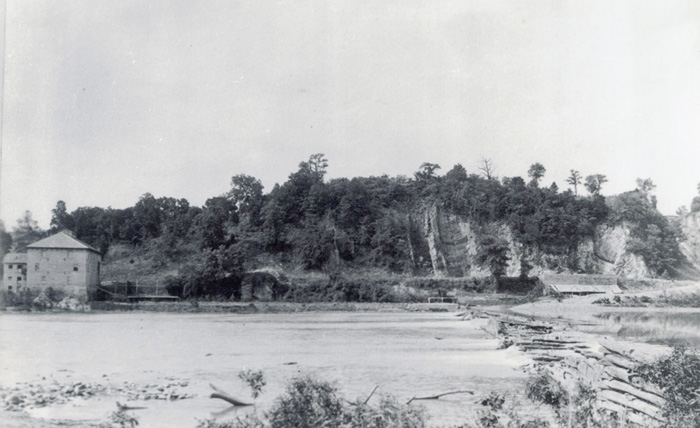 Looking across Potomac at the Cement Mill. The wooden mill dam is on the right.