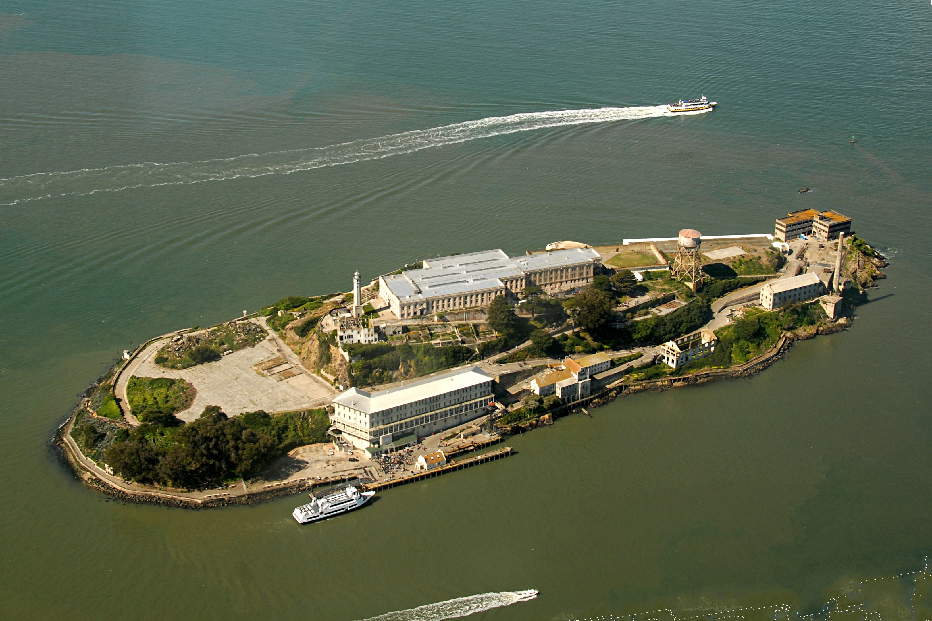 """Alcatraz Island view from the West.   """"Alcatraz Island aerial view"""" by Ralf Baechle, Licensed under CC BY-SA 4.0 via Wikimedia Commons."""