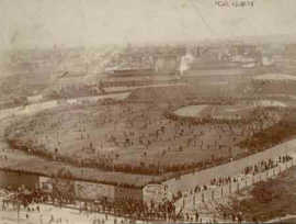 View of the field full of spectators - rope was the greatest barrier to spectators, so eager fans would sometimes close in on the field in a ring, as shown here. (Boston Public Library)