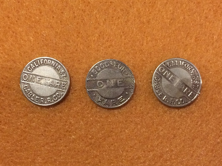 """Historic cable car tokens from the San Francisco Cable car museum"" by Jaredzimmerman (WMF). Licensed under CC BY-SA 4.0 via Wikimedia Commons."