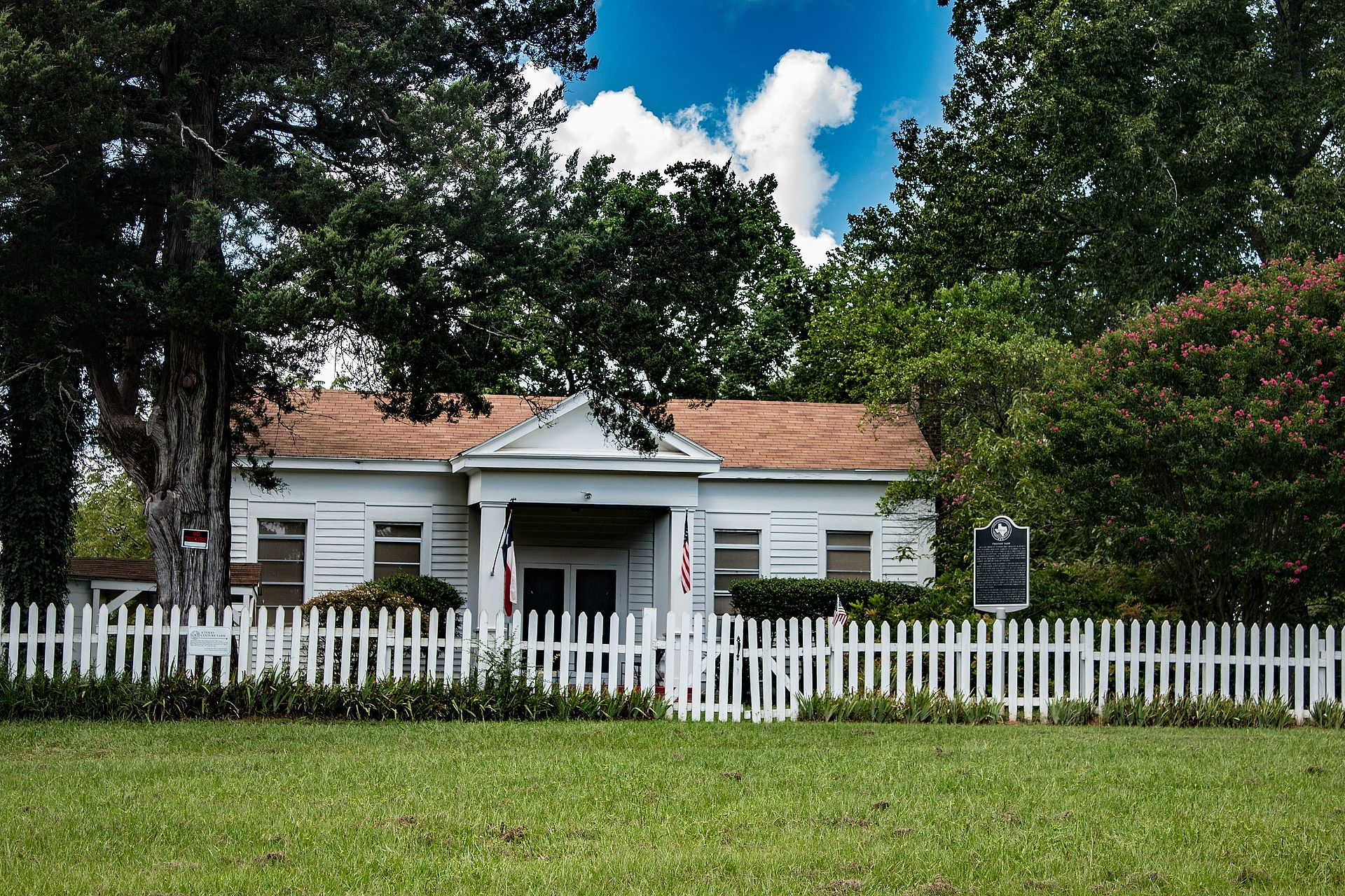 The farmhouse was built in 1854 in the Greek Revival style.