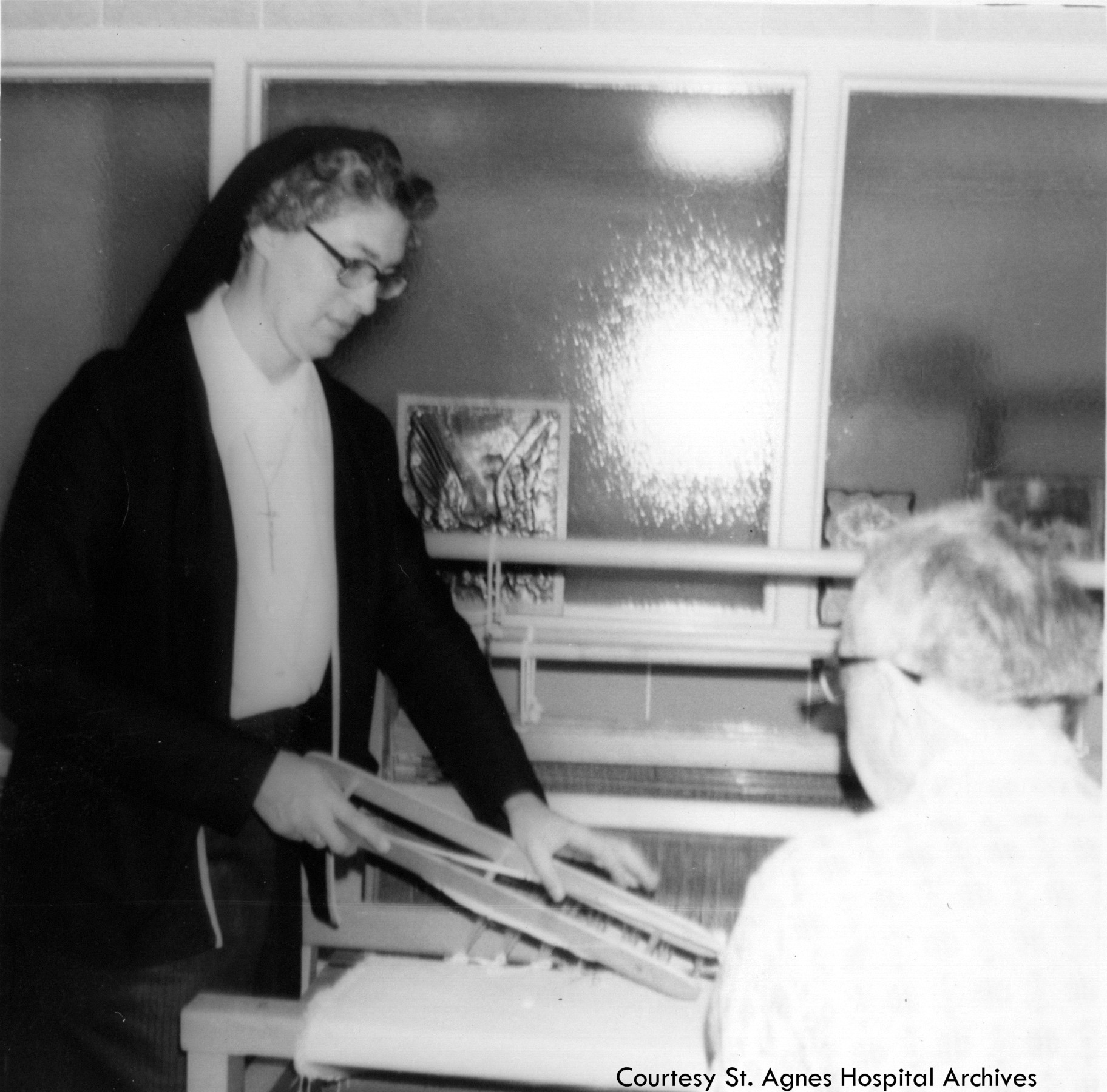Sister Mary Christopher Esler with an occupational therapy patient at St. Agnes Hospital, 1970s.