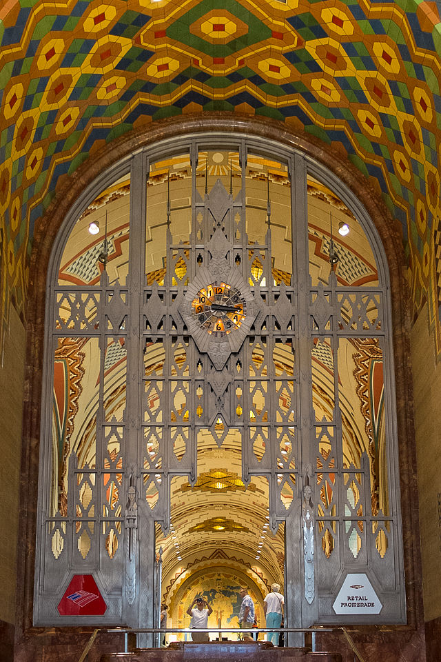 "Tiffany clock in metal framework separating the lobby from the promenade. ""Guardian Building Detroit Interior Clock"" by Vincent Arel. Licensed under CC BY-SA 3.0 via Wikimedia Commons"