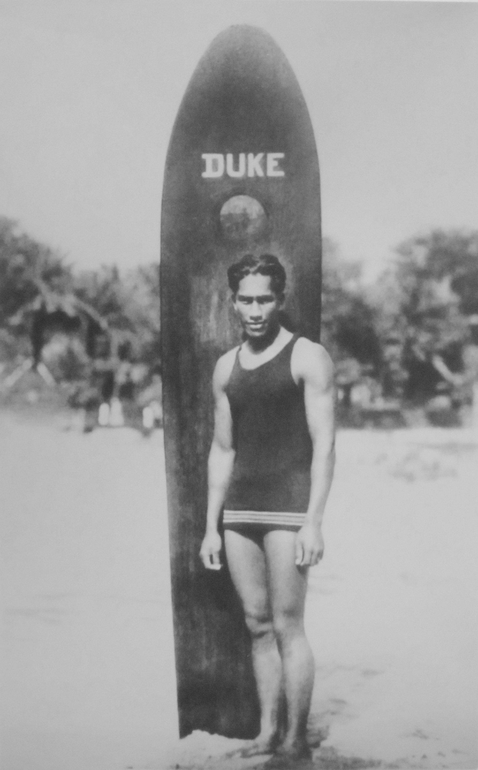 Duke Kahanamoku with his Surfboard