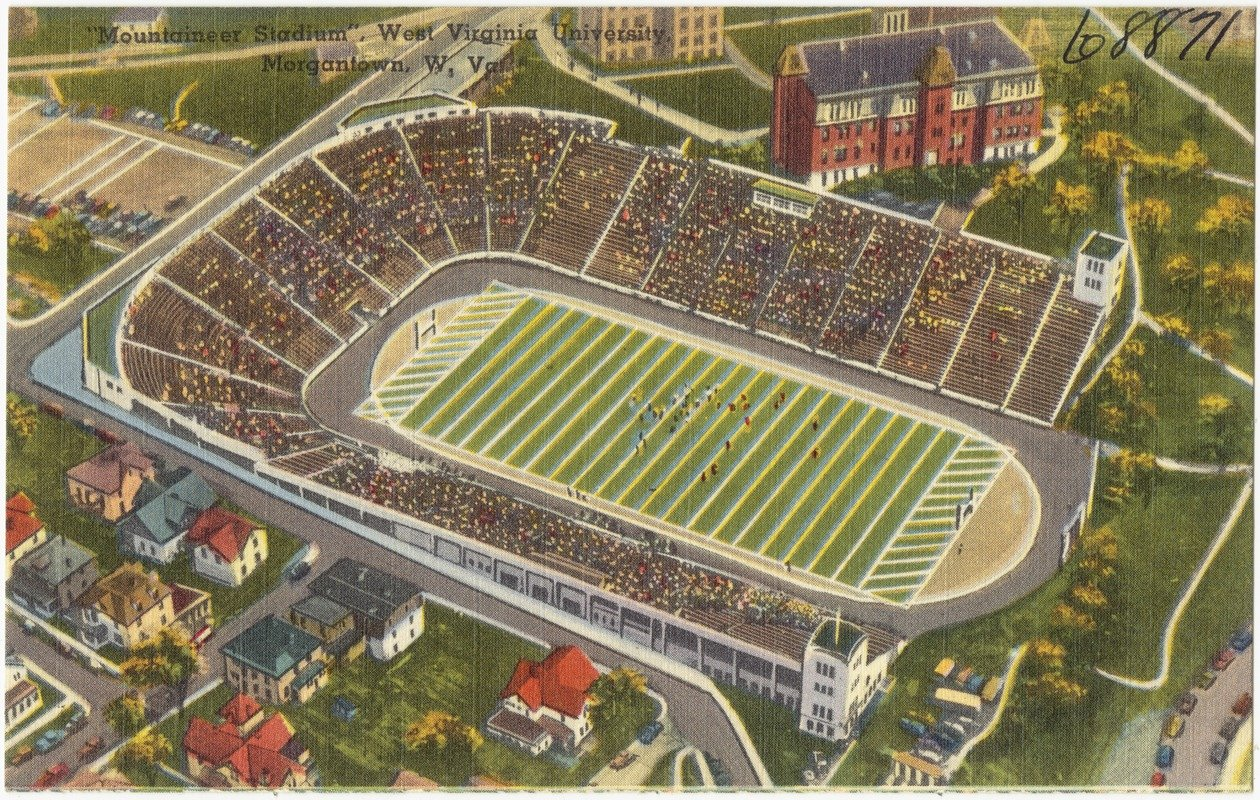 "An early ""aerial"" view of the original Mountaineer Field from the 1930s or 1940s in one of the ubiquitous Tichnor Brothers postcards of the era. Fans without tickets often watched games from nearby downtown rooftops."