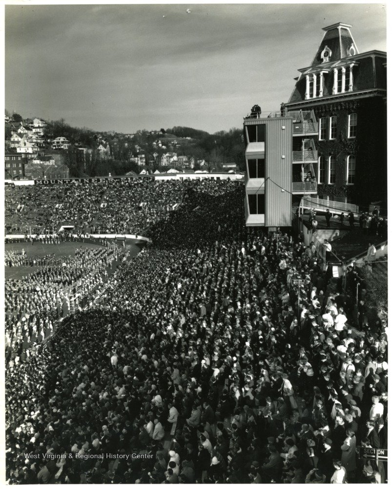 Fans pack the stands of the original Mountaineer Field for Band Day in 1965.  West Virginia & Regional History Center.