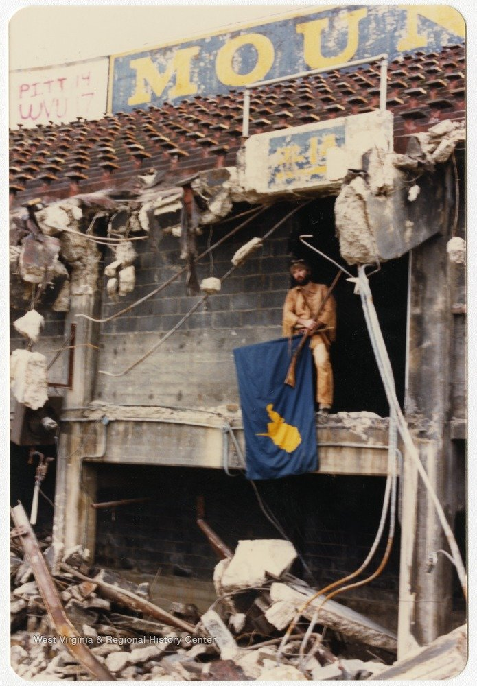 Official Mountaineer mascot Matthew Zervos laments the loss of the original Mountaineer Field in the mid-1980s as the demolition is in progress. West Virginia & Regional History Center.
