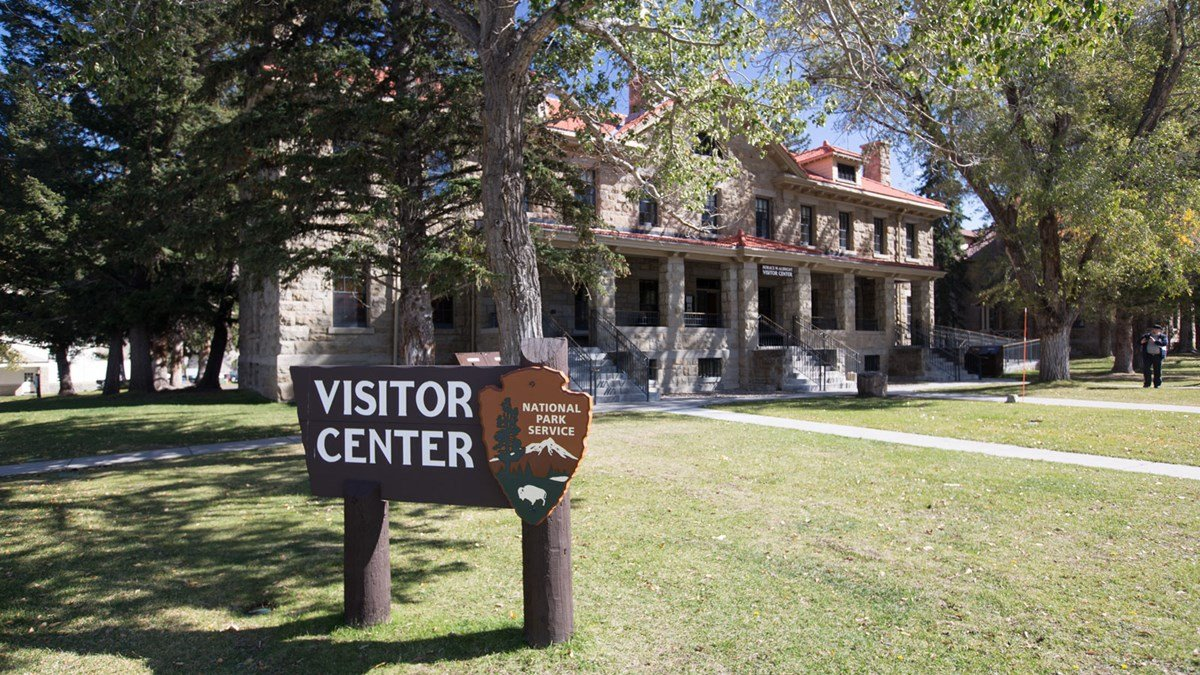The Albright Visitors Center and Museum is located next to the Mammoth Hot Springs, one of the park's popular natural features.