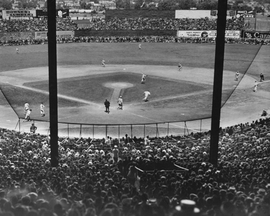A view of the field from the stands during a game (Sourced from http://www.bu.edu/today/2012/braves-field-remembering-the-wigwam-2/, Boston Public Library)