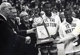 The 1965-66 National Champion Texas Western Miners receiving trophy.