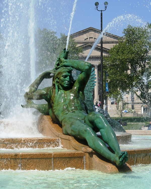 Delaware River - represented by powerful male figure reaching above his head to grasp his bow as a large pike sprays water over him