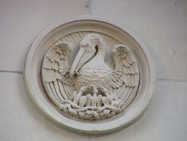 A close up of one of the bas-relief sculptures that dot the building's exterior.