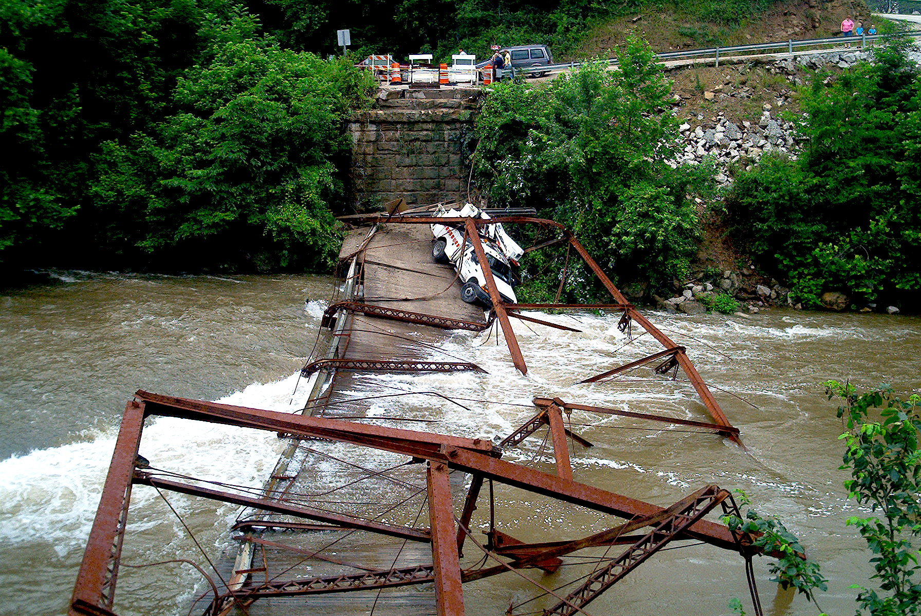 Another view of the collapsed bridge and the truck that caused it.