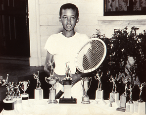 Ashe as a youth with his trophies