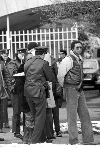 Arthur Ashe under arrest in 1985 after protesting in front of the South African Embassy