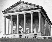 The capitol in 1865, Union soliders stand in front.