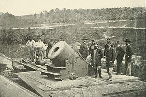 "The ""Dictator"" siege mortar at Petersburg. In the foreground, the figure on the right is Brig. Gen. Henry J. Hunt, chief of artillery of the Army of the Potomac."