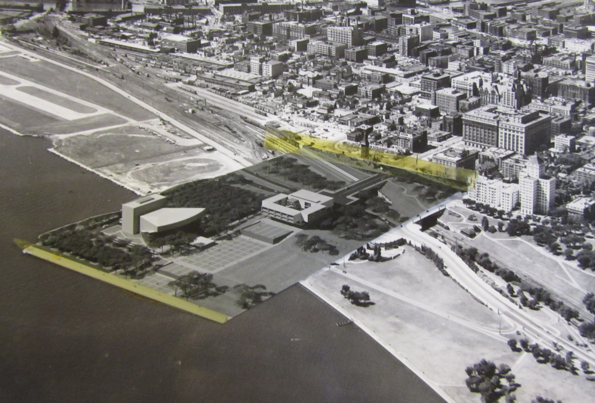 Aerial view of the lakefront with a taped picture of Eero Saarinen's model of the War Memorial Center and a concert hall which was never built.