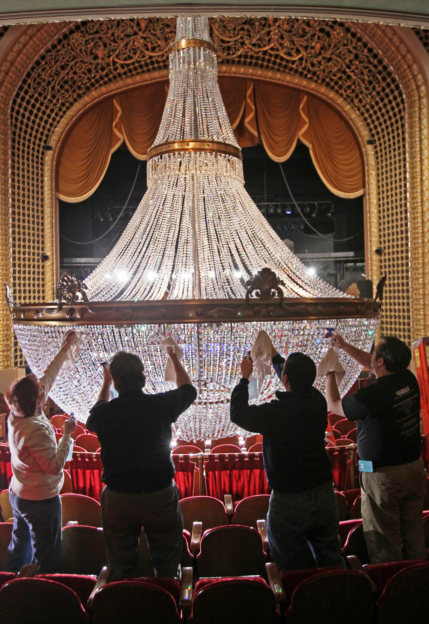 Workers cleaning the chandelier. Credit: Milwaukee Journal Sentinel