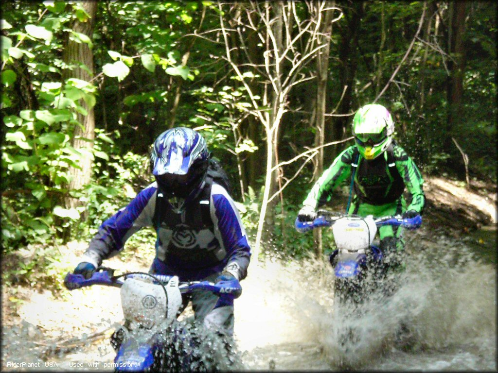 Two Yamaha Riders Crossing the Water.