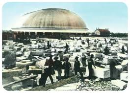 Color-rendered photo of temple workers preparing granite for temple construction. Famous Tabernacle sits in the background. This photo was likely taken in the 1860s.