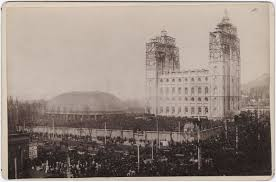 Crowds gather in temple square of the placing of the Angel Moroni capstone on highest pillar. April 6, 1892