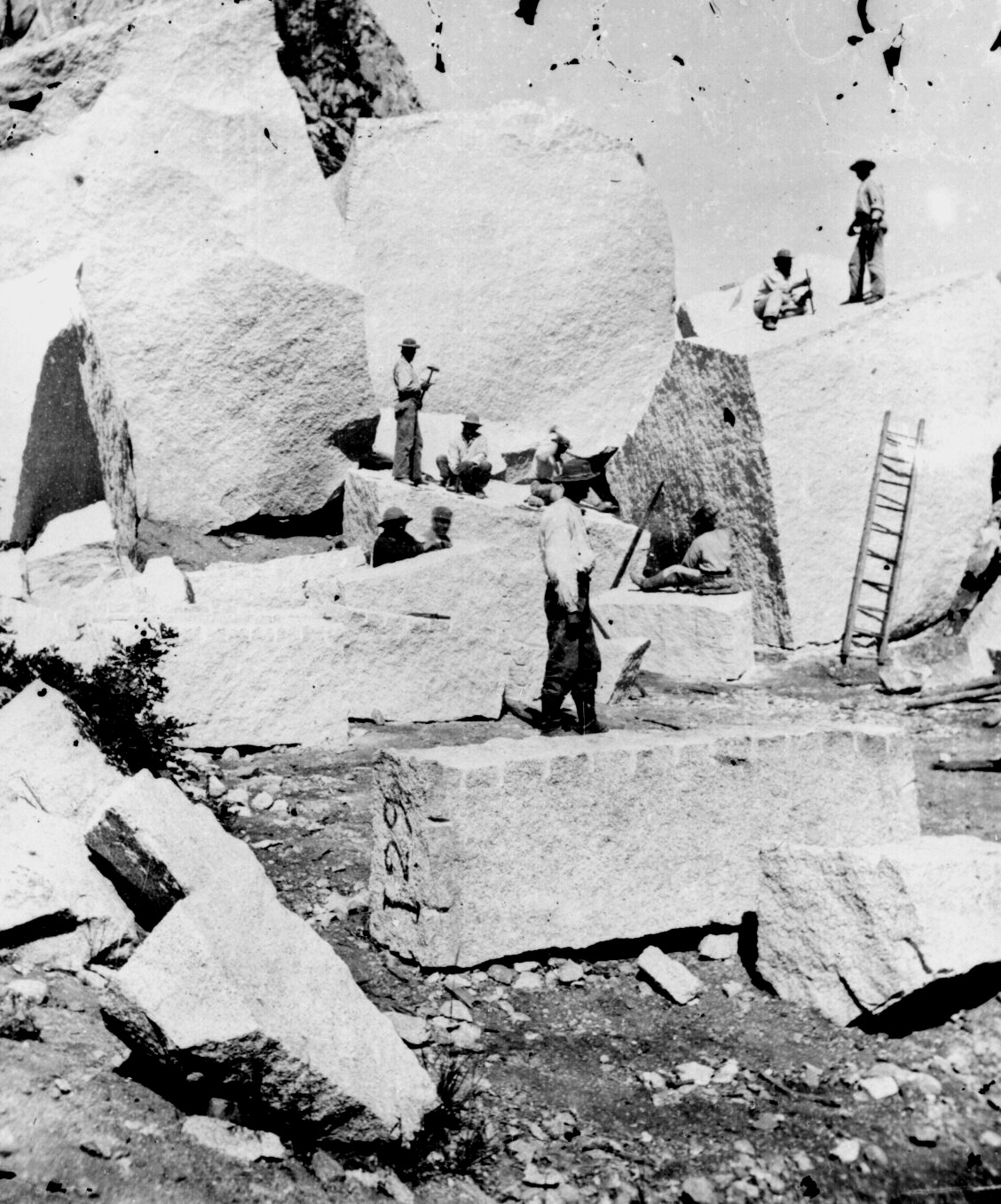 Stone cutters in at Little Cottonwood Canyon carve out granite for temple.  Canyon was 20 miles SW of the temple. Stone first hailed by oxcart then train starting 1871.