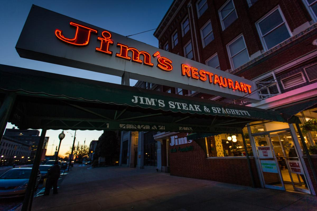 Jim's sign lit up at night