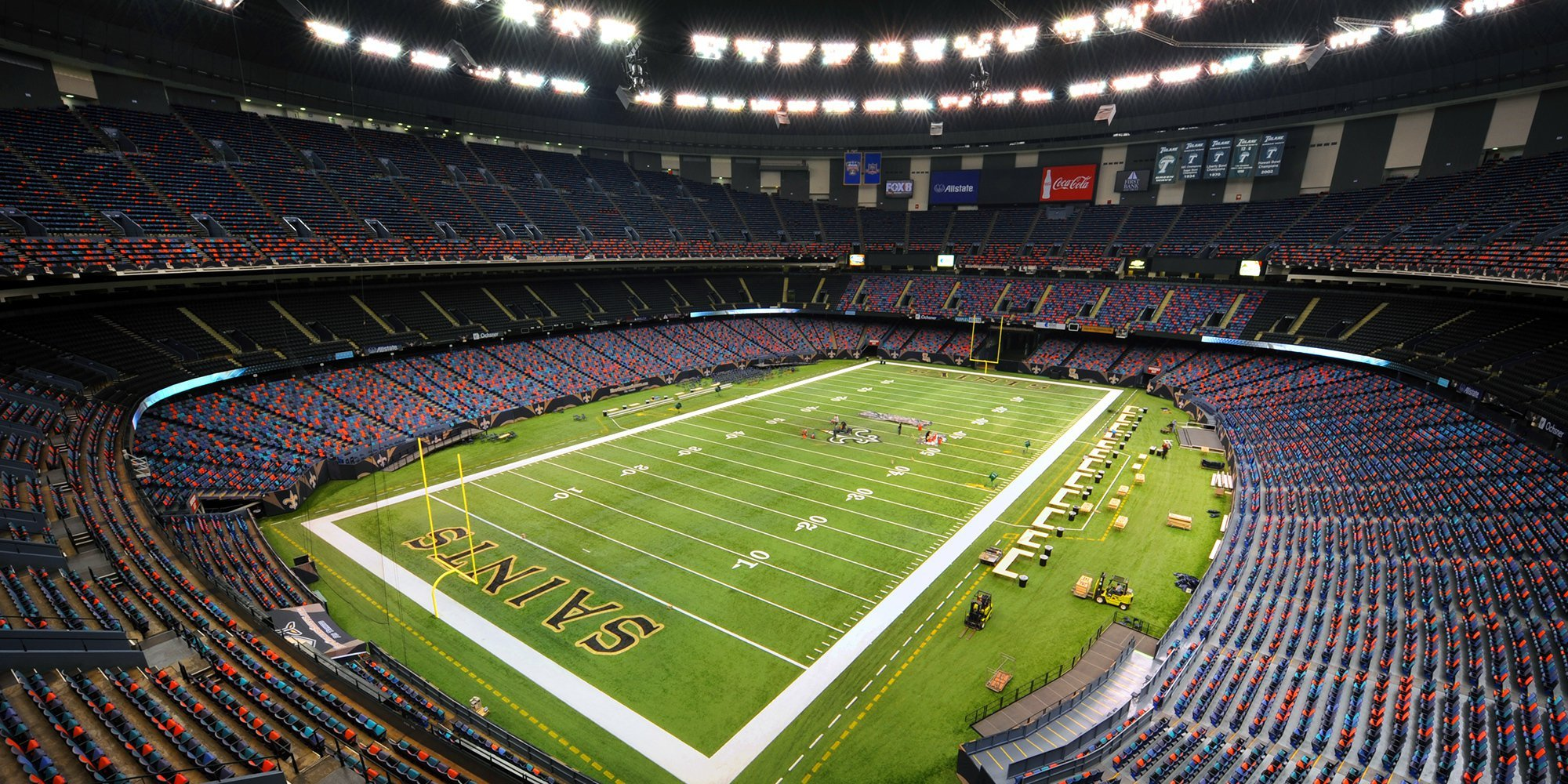 This photo is a picture of the inside of the Superdome. Here is the field where the New Orleans Saints play their home games.