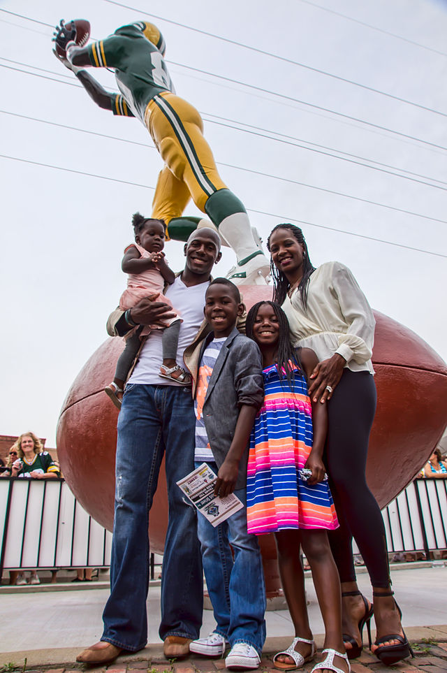 Former Packers wide receiver Donald Driver and his family stand in front of the newly unveiled state dedicated to him in 2013. Credit: Chris Rand