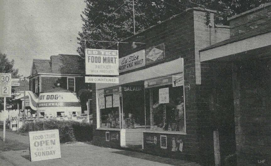 Advert for the Ed Tice Food Mart. 118 Carolina Ave, Chester, WV. In the background is the Teapot when it was used as a hot dog stand. Photo from a 1959 Polaris yearbook.