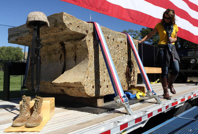 A piece of concrete from the World Trade Center arrives for the installation of the Memorial for Fallen Soldiers.