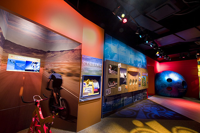 Bicycling and bowling displays.
