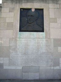 The memorial features a bronze image of Coles and an inscription that credits him for keeping slavery out of the Illinois Constitution.
