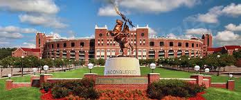 The Unconquered Statue with Doak S. Campbell Stadium as the backdrop.