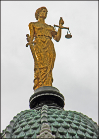 On top of the copper shingles of the cupola is a bronze statue of Justice. The statue was part of the building's original plan but was not par of the building until renovations in 1988.