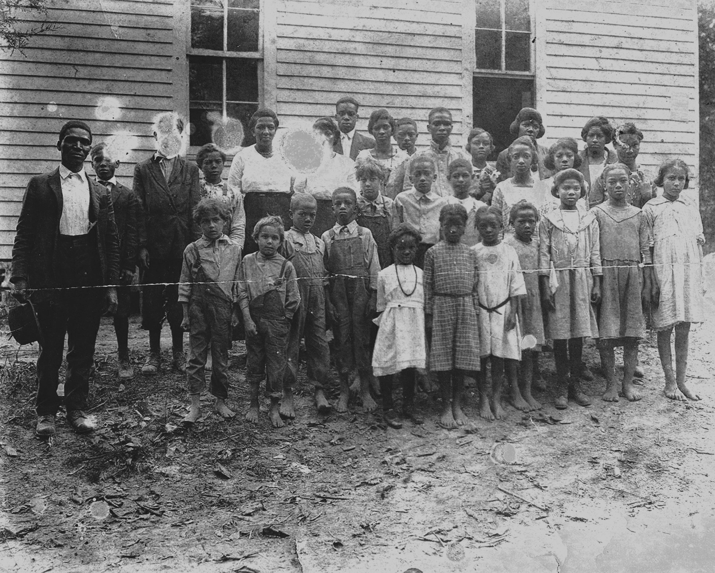 School children and their teacher at the Coe Ridge Colony.