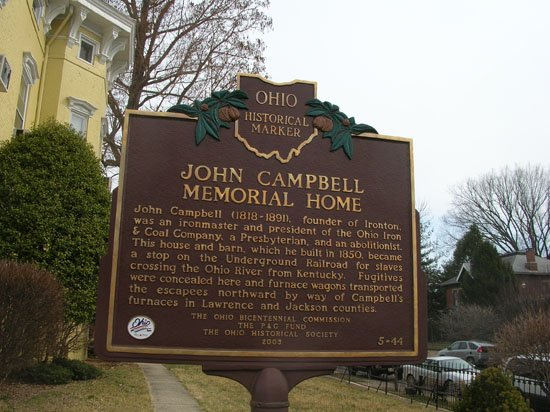 "Marker for the John Campbell Memorial Home which reads, ""John Campbell (1818-1891), founder of Ironton, was an ironmaker and president of the Ohio Iron & Coal Company, a Presbyterian, and an abolitionist. The house and barn, which he built in 1850, b"
