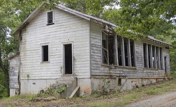 This rural school closed in 1964. Local community members are working to restore the school and operate a historic site at this location.