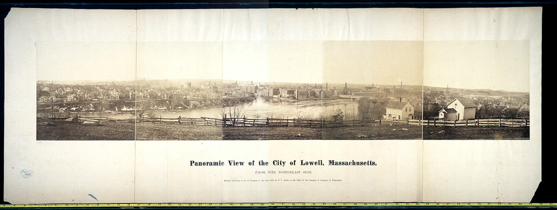 A photograph of the city of Lowell, ca. 1874. Visible here is the river that powered the mills (and served as a dumping ground for factory waste) as well as the mills themselves.