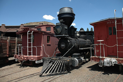 Some of the older locomotives and cabooses on display behind the museum.