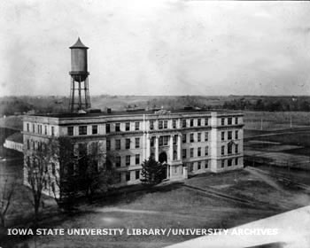 Older photograph of Engineering Hall and the water tower behind it