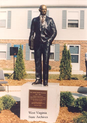 Carter G. Woodson Statue located on Hal Greer Boulevard
