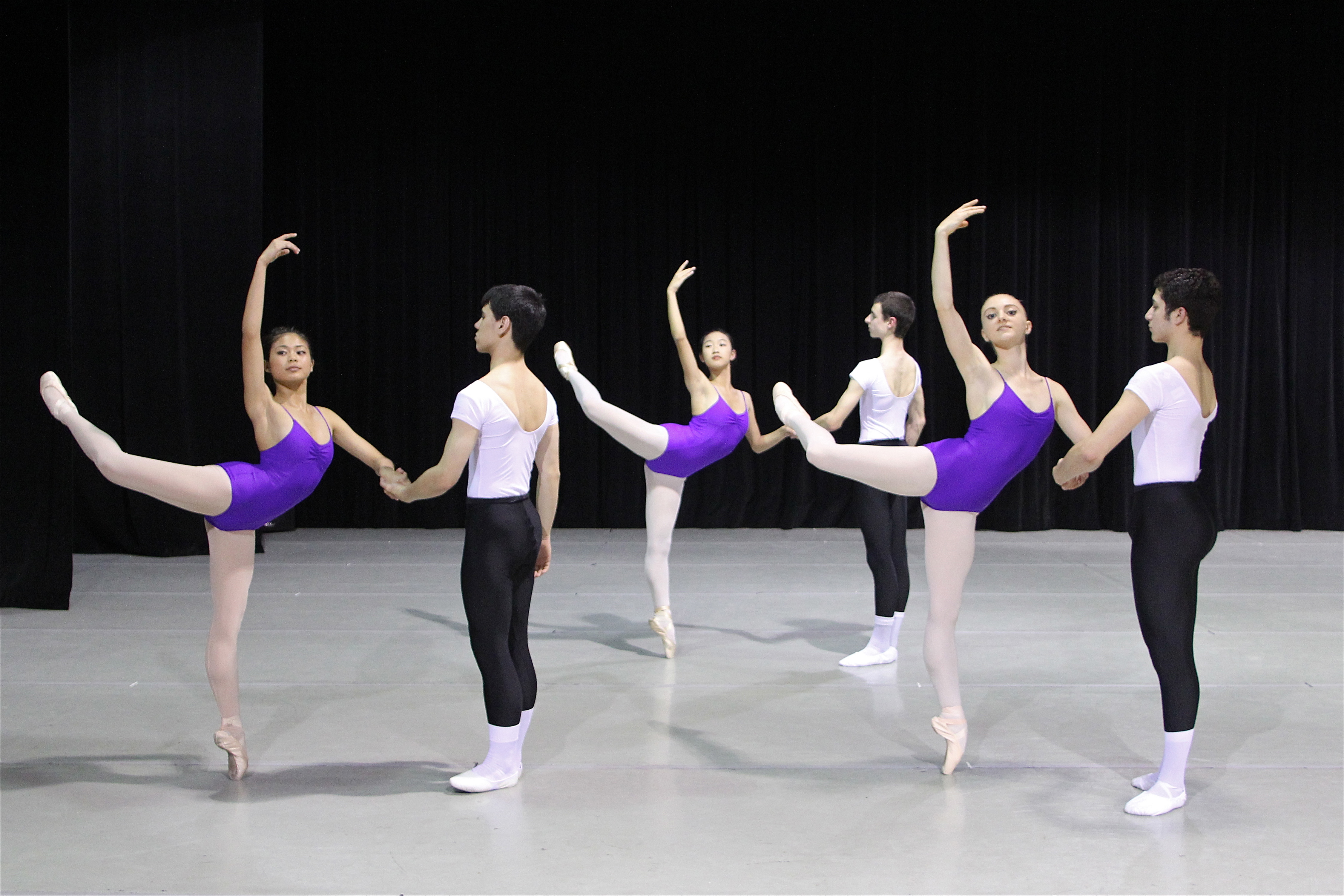 Students of the American Ballet Theatre practice dancing with their partner.