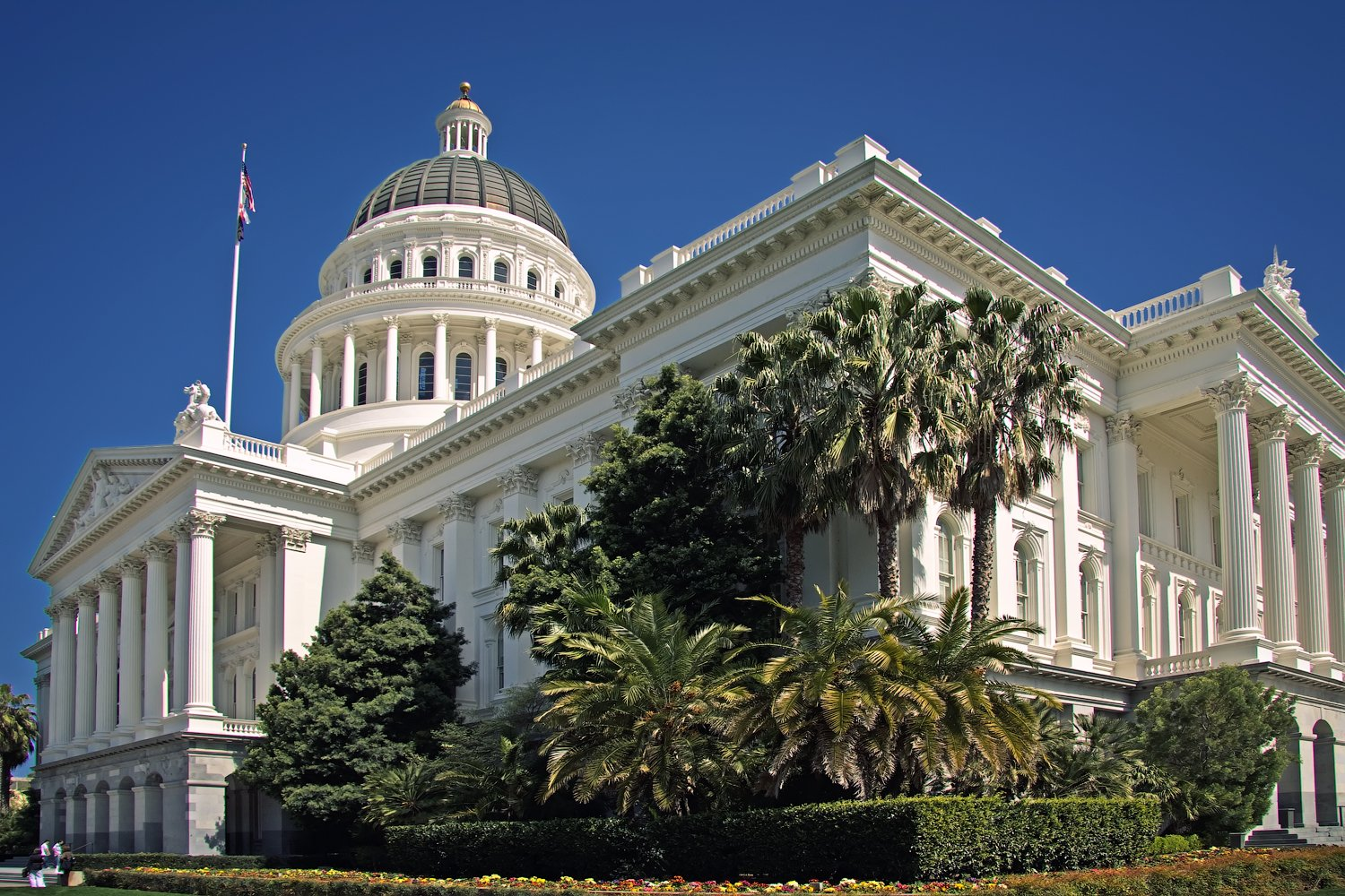 The California State Capitol Museum is housed inside the historic Capitol building, which is designed in the neoclassical style with large columns and a dome. Wikimedia, Steven Pavlov.