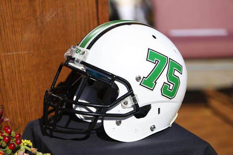 One of many traditions, the Marshall football team wear helmets and play in honor of the 75 at the home game preceding November 14th each year.